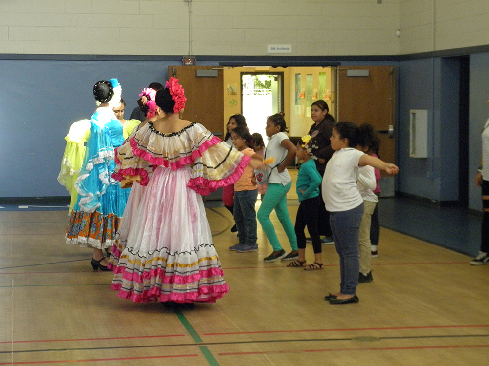 Kids learn Folklorico dance