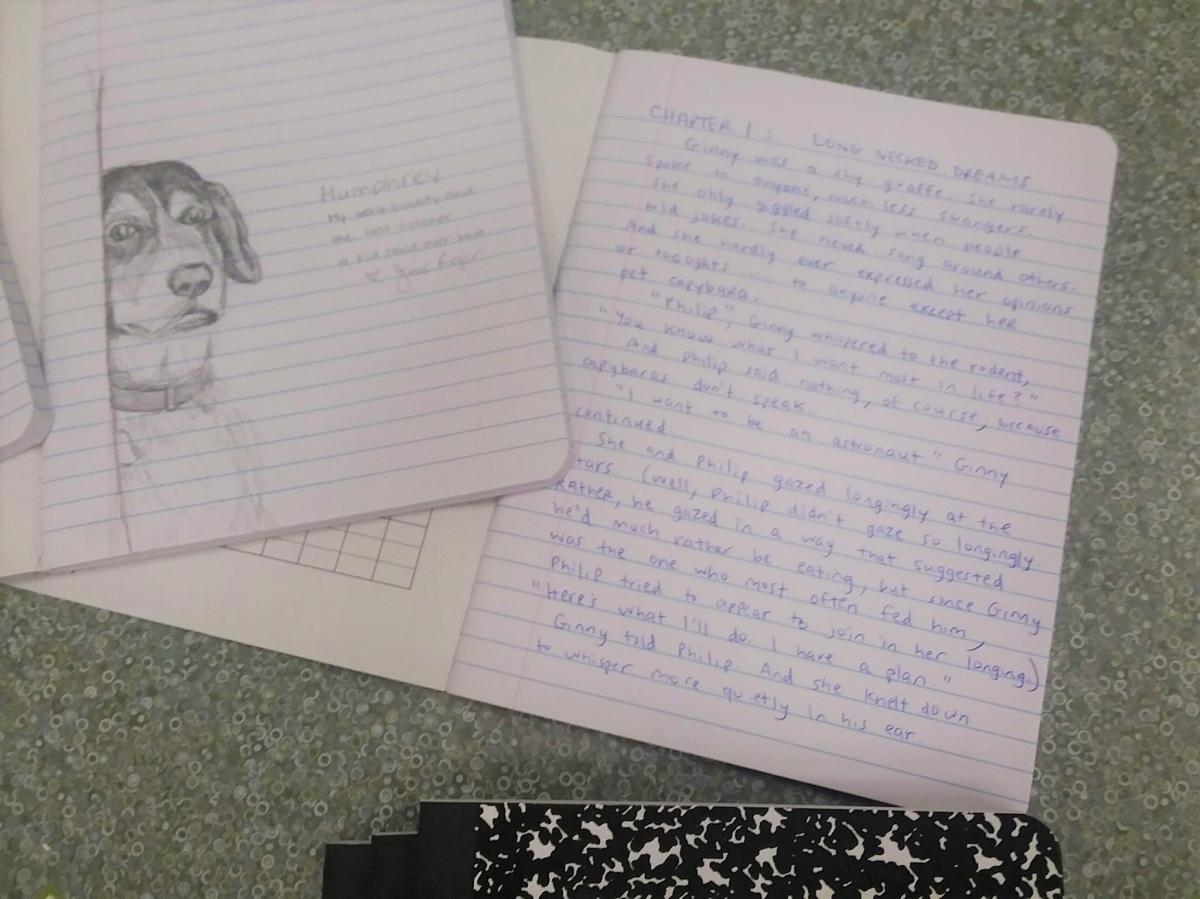 Photo of journal with writing and journal with the sketch of a dog.