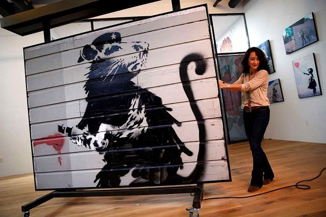 The Kokomo-Howard County Public Library (IN) will become what is thought to be the first library in the world to host a piece of art by the street artist Banksy.