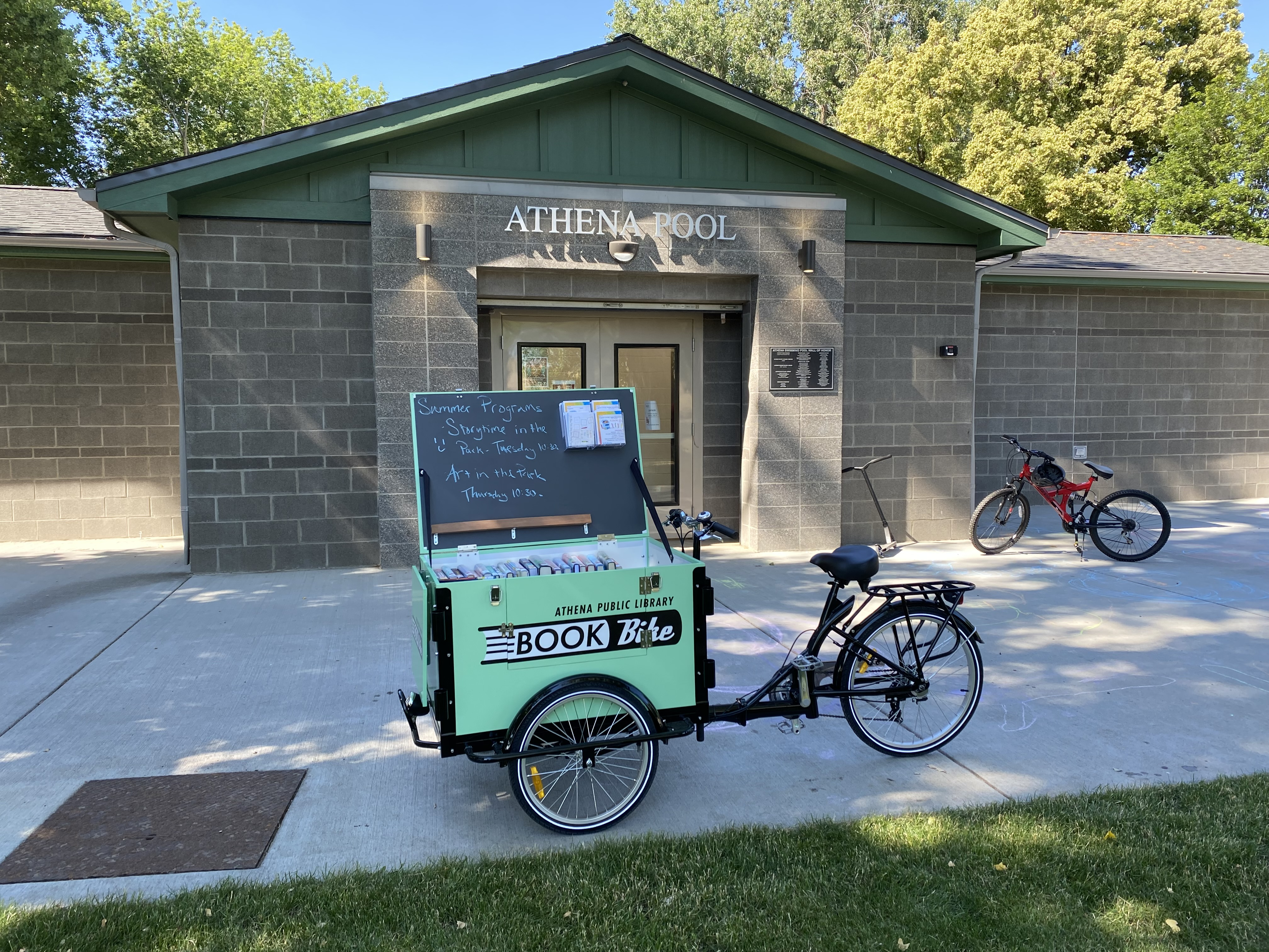 Photograph of the book bike at the local pool.