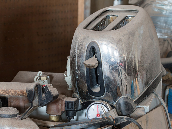 An old, dusty toaster ready for repair