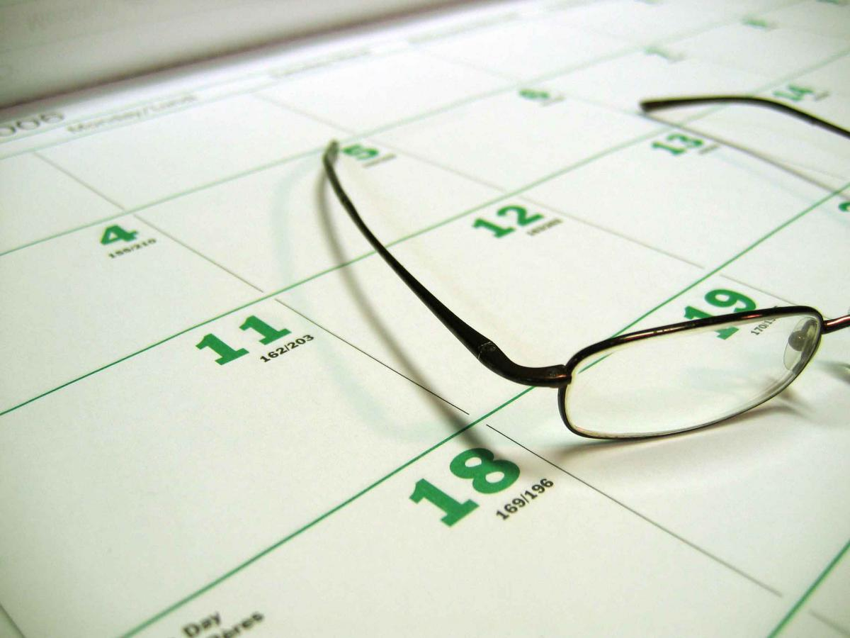 Calendar with glasses atop it