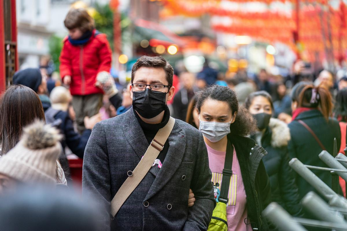 people wearing masks in a crowd