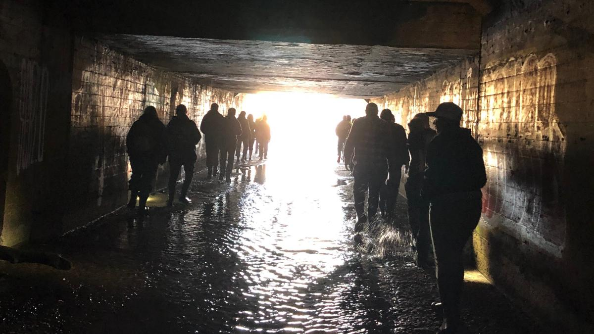 tour group walking through tunnel