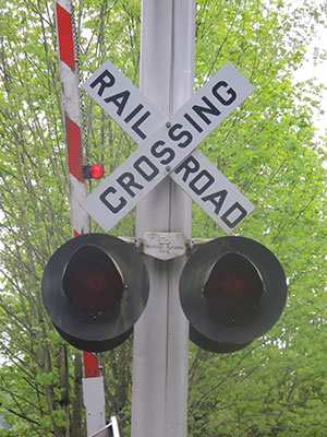 A rail crossing at the Cross Kirkland Corridor, a former railroad right of way extending through the entire city of Kirkland, Washington  (Elsa Steele)
