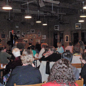 "A full house attends ""Poetry After Dark"" with New Orleans Poet-in-Residence Mark Doty."