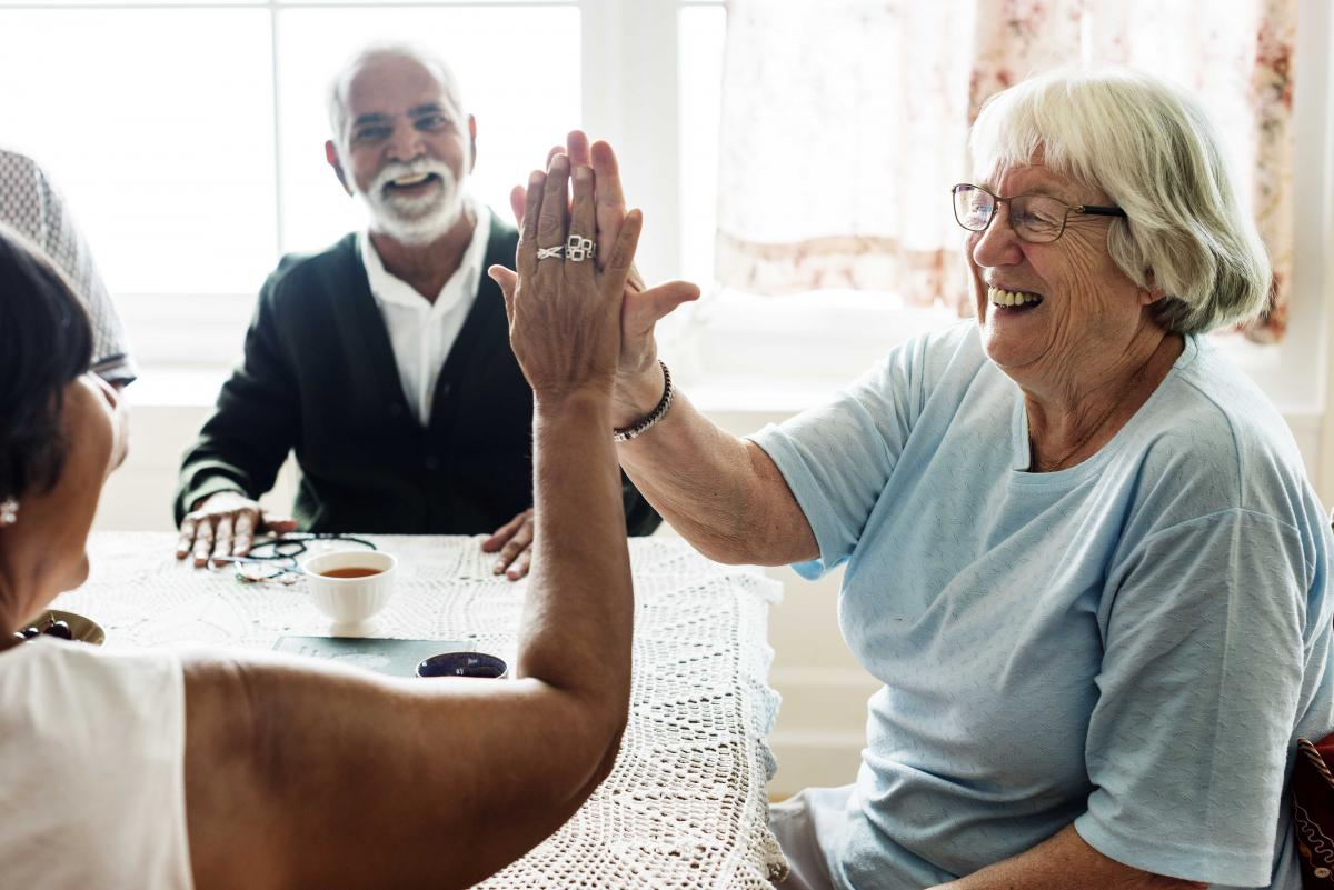 Older adults touching palms