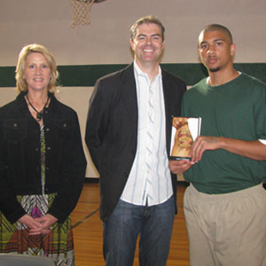 Library media specialist Francie Clinton and author Coert Voorhees pose with a Great Stories CLUB participant at the Southwest Oklahoma Juvenile Center in November 2011.