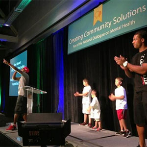 People on stage at a Creating Community Solutions event