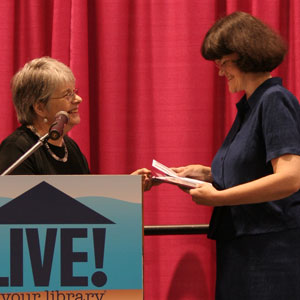 Sandra Wiseman accepts the 2008 Jaffarian Award from Jaffarian selection committee member Barbara Immroth.