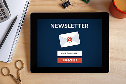 Email newsletter icon on a tablet