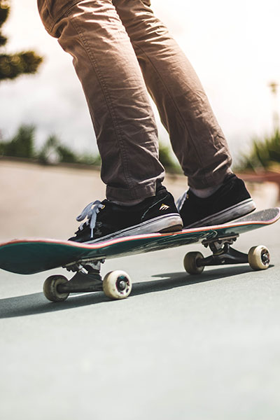 Person riding skateboard on the road