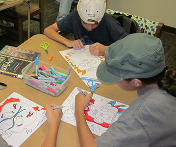 Tweens create art at a Mana-Tweens program.
