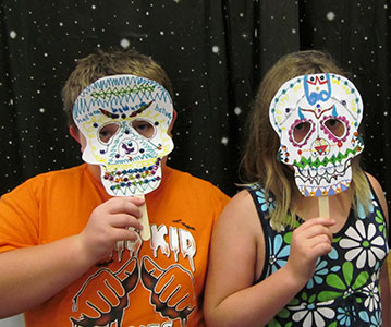 Tweens create masks at a Mana-Tweens program.