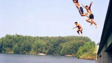 Boys jumping into water
