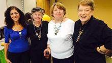 Creative Aging program participants show off their reclaimed jewelry.
