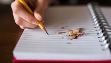 A broken pencil on a notepad