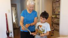 A boy and his grandmother reading