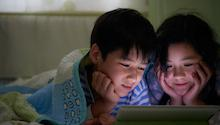 Kids watching a show on an iPad