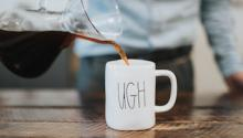 "Pouring coffee into a mug that says ""ugh"""