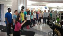students singing in a poetry month performance