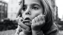 A grayscale photo of an exasperated-looking girl