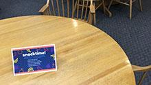 Table tent advertising on a library table