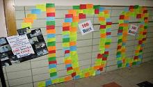 Wall of 100 books read by students on the 100th day of school.