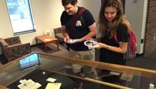 Students looking at exhibit