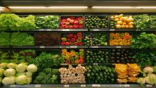 Photograph of vegetables in a grocery store.