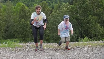 Mother and son run in a race.