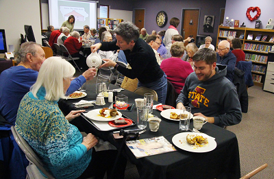 Patrons at Slater Public Library share a meal and prepare to listen to entertainment at Soup and Sound