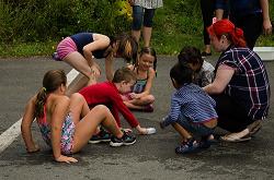 Kids sitting in a circle. Photo credit: Craig Scott