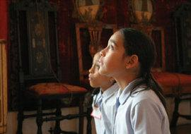 """Two elementary students with """"eyes on canvas"""" at the Isabella Stewart Gardner Museum."""