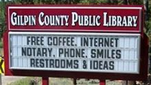 "Sign for the Gilpin Public Library: ""Free coffee, internet, notary, phone, smiles, restrooms & ideas"""
