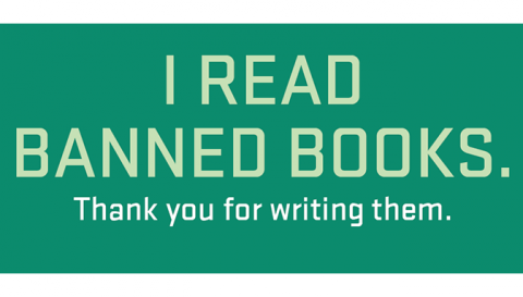 "A dark green background with light green text that reads ""I Read Banned Books. Thank you for writing them."" All letters are capitalized."