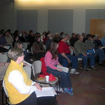 """Community members attend """"Understanding and Responding to Poverty Among Children and Their Families in Johnson County"""" at the Johnson County Library in Overland Park, Kansas"""