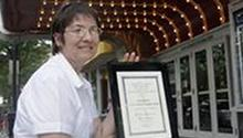 Nicolette Vaillancourt with the Jaffarian Award plaque, under the lights of the York Theater in Elmhurst, Ill.  Sarah Minor