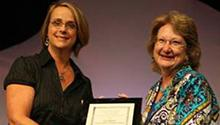 Sally Rasch (r), accepting the 2009 Jaffarian Award from Lisa Hathcock (l), award selection committee chair.