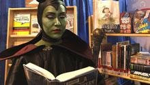 Cosplayer reading a book