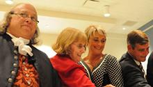 """Ribbon cutting for the opening of the """"Benjamin Franklin: In Search of a Better World"""" traveling exhibition with Ben Franklin (Christopher Lowell); Julie McDaniel, and Sherry and Greg Stocksdale."""