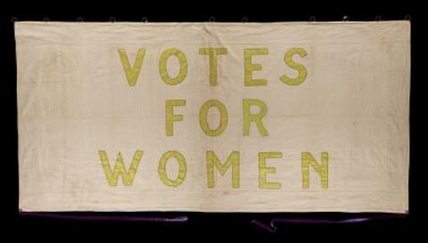 Photograph of an old 'Votes for Women' poster.