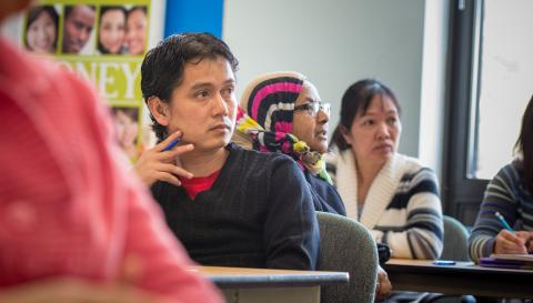 Photograph of people in a financial literacy class.