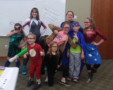 A group photo from a superhero program