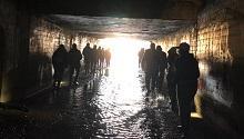 tour group walking through tunnel