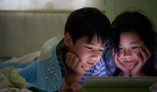 Kids watching a show on an iPad