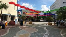 A Little Havana walkway is decorated with upside down umbrellas.