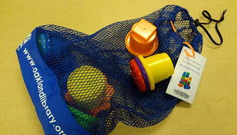 Toy in Oakland Public Library bag