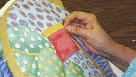 Person quilting at the MCPL-Kearney Branch