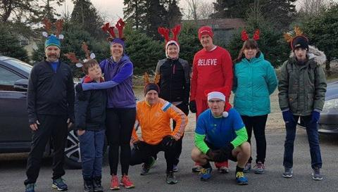 A group of runners outdoors for the LP Fisher Public Library's Reindeer Run